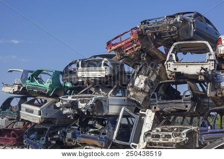 Old cars on junkyard are waiting for recycling proces stock photo