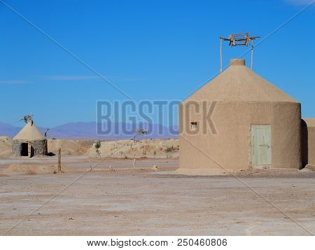 Amazing water well buildings of Ketthara at african sandy Sahara desert landscapes near city of Erfoud in Morocco with clear blue sky in 2017 cold sunny winter day on February. stock photo
