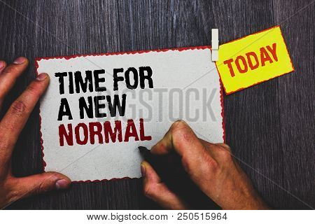 Handwriting text writing Time For A New Normal. Concept meaning Make a big dramatic change Replace the expected Hand grip black marker writing text paperclip stick written page woody deck stock photo