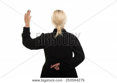 Portrait of young blonde female teacher wearing glasses showing oath gesture isolated on white background with copyspace advertising area stock photo