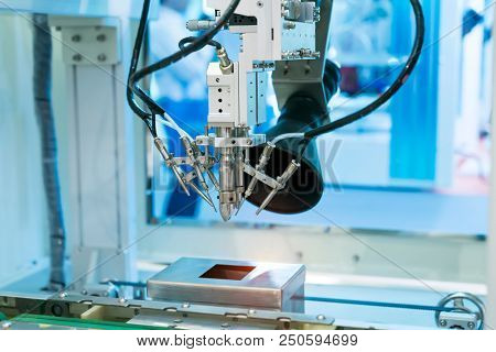soldering robot used in soldering high-heat-sink applications such as a multilayer board and shielding case stock photo