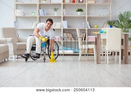 Disabled cleaner doing chores at home stock photo