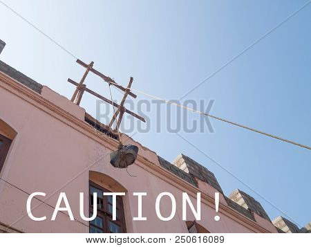Carefully, at the top is a heavy full bucket on an unreliable rope. Attention, the bucket can fall on your head stock photo