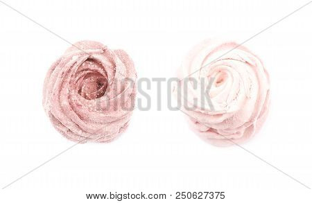Marshmallow pink zephyr confection isolated over the white background, set of two different foreshortenings stock photo