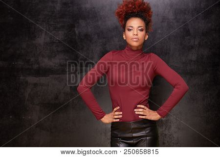 Studio fashion portrait of beautiful african american woman on dark background. Stylish autumn look . stock photo