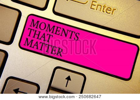 Handwriting text Moments That Matter. Concept meaning Meaningful positive happy memorable important times Crystal orange computer keyboard pink button written texts enter word stock photo