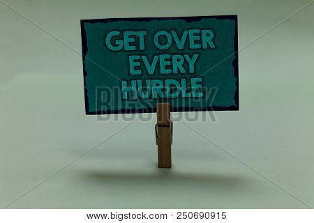 Writing note showing Get Over Every Hurdle. Business photo showcasing Overcome any obstacle problem trouble adversities paperclip grip black lined green page with outlines grey background stock photo