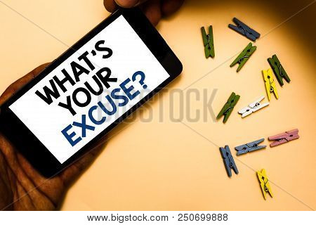 Conceptual hand writing showing What s is Your Excuse question. Business photo text Explanations for not doing something Inquiry Hand holding phone with letters and paperclip peach color ground stock photo