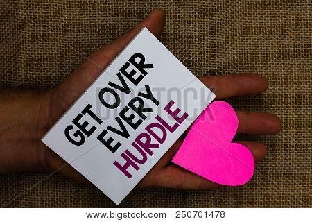 Word writing text Get Over Every Hurdle. Business concept for Overcome any obstacle problem trouble adversities Human hand touched white page with letter and love symbol sack base stock photo