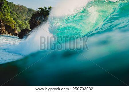 Breaking barrel wave in ocean. Blue wave in Bali, Padang Padang stock photo