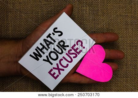 Word writing text What s is Your Excuse question. Business concept for Explanations for not doing something Inquiry Human hand touched white page with letter and love symbol sack base stock photo