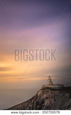 Beautiful sunrise at the Carboneras lighthouse in Almeria stock photo