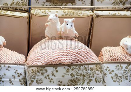 Cute mouse toy with tea cup sitting on sofa. Soft animal toy. Good morning concept. Childhood background. Romantic gift. Funny soft mouse toy. Gentle colors. stock photo