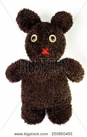 Handcraft fluffy brown yarn mixed between bear and bunny doll on isolated white background, pity eyes with red muted mouth. stock photo