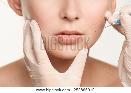 Cosmetologist beauty skin. Facelift spa cosmetology treatment. Model body surgery. stock photo