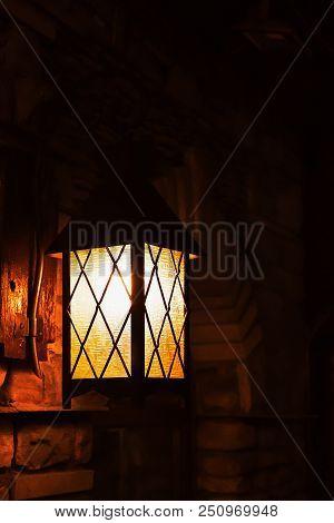 Street lamp iluminated in yellow. Urban illumination for night stock photo
