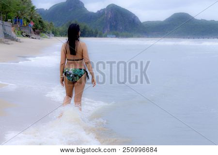 Woman body beautiful and bikini relax on beach at Klong Wan beach, Prachuap Khirikhan Province Thailand stock photo