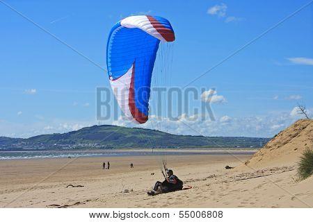 paraglider on the sand dunes of Aberavon beach stock photo