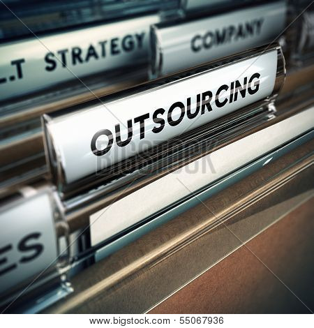 Folder tab with focus on the the word outsourcing. Contracting out or subcontracting concept image with blur effect. stock photo