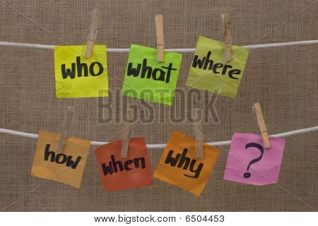 who what where when why how questions - uncertainty brainstorming or decision making concept colorful crumpled sticky notes hanging on clothesline against canvas background stock photo