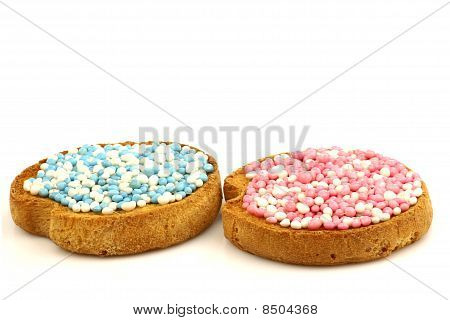 Rusks with white and blue and white and pink anise seed sprinkles served in Holland when a baby boy or girl is born or twins from both gender stock photo