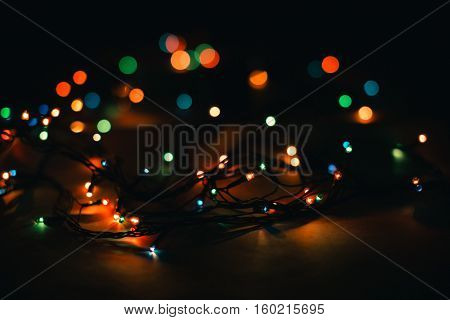 Christmas lights and vintage lantern on black background. Merry Christmas. Christmas. Happy Christmas. Christmas background. Christmas light. Christmas decorations.