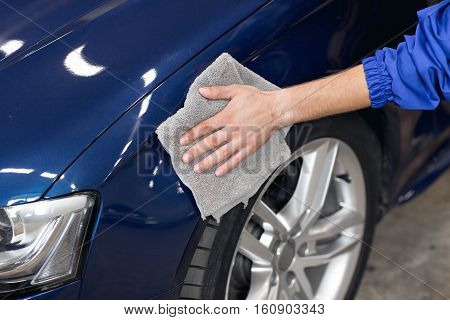 A man polishing cleaning car with microfiber cloth, car detailing or valeting concept stock photo