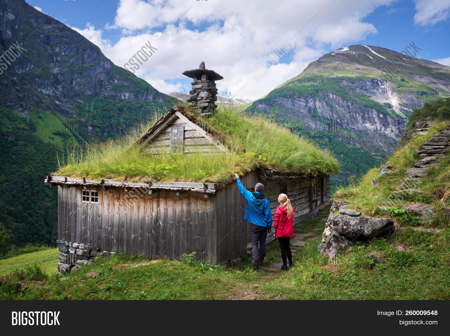 adventure,architecture,countryside,couple,divot,famous place,farm,grass,green,greensward,guy,hike,hiker,hiking,historic,home,kagefla,landmark,landscape,mountain hut,mountains,north,northern,norway,norwegian,old,roof,rural,scandinavia,scenery,scenic,sights,sod,stroll,summer,tourism,tourist attraction,traditional,travel,traveler,turf,turf houses,vacation,walk,woman,wooden
