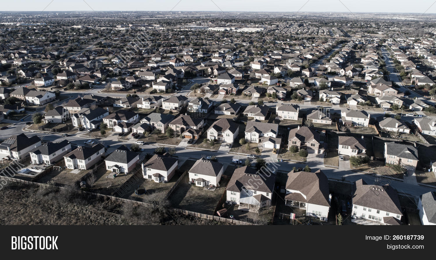 Round Rock Suburbia curved street on neighborhood layout Urban development aerial drone view high above Suburb neighborhood community homes and houses in a huge modern development in Austin , Texas , USA architecture