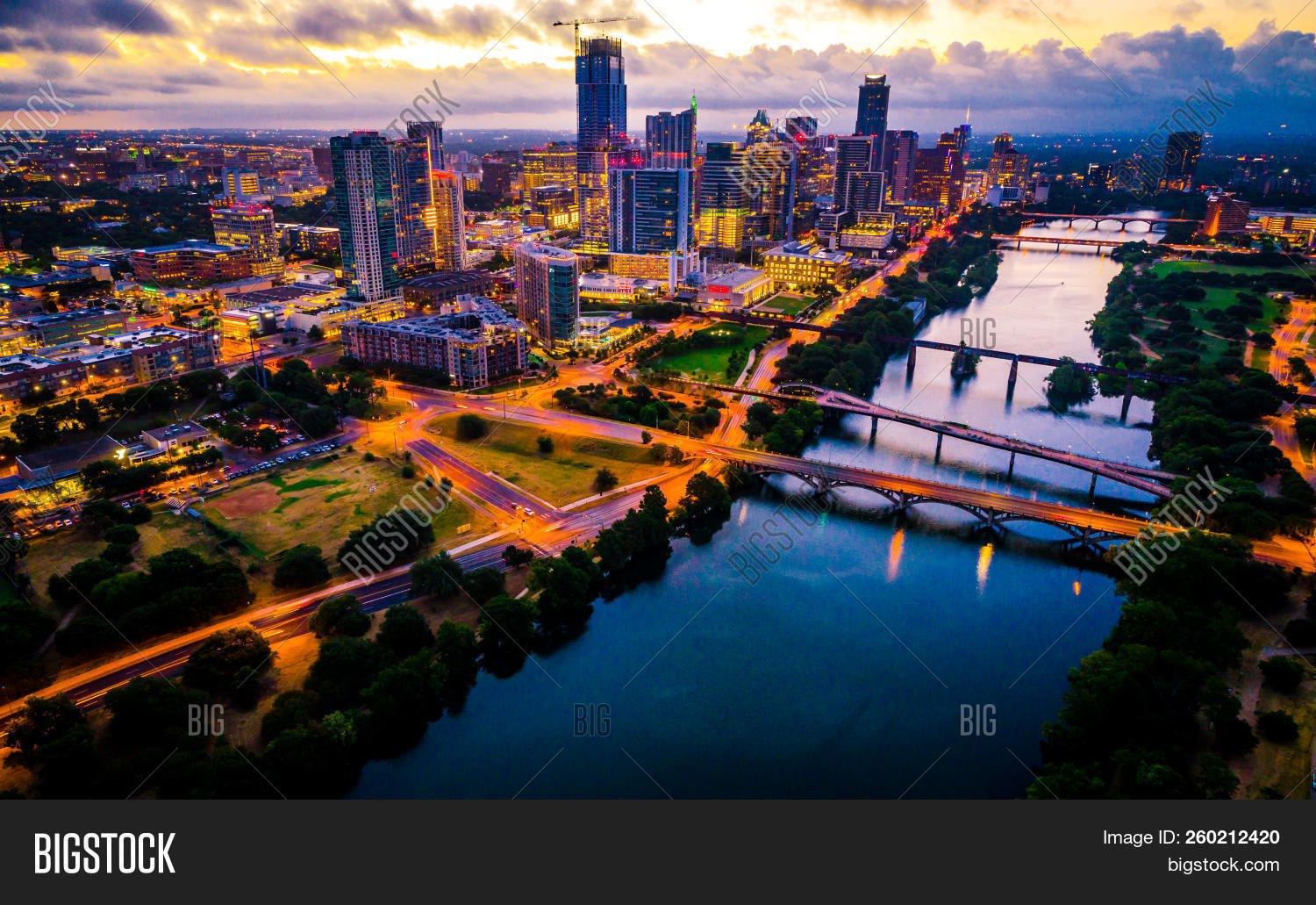 Aerial,Austin,Cityscape,Dawn,Downtown,Lake,Skyline,Texas,Town,and,as,at,bridges,capital,city,drone,glow,hits,illuminated,in,lights,of,on,over,right,sunrise,the,view,with