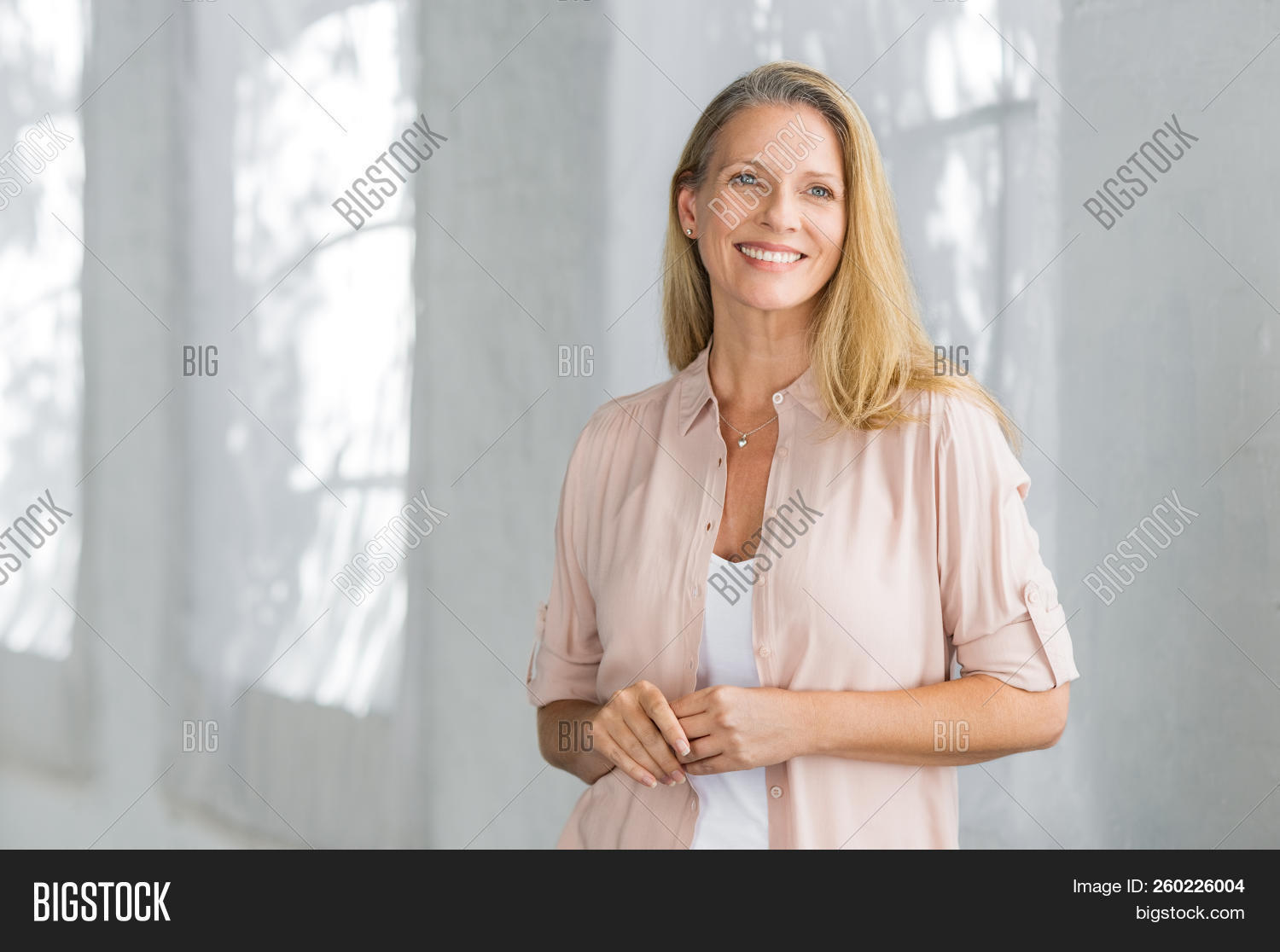 aging,aspiration,attractive,beautiful,beautiful woman,beauty,blond,blonde hair,carefree,casual,caucasian,cheerful,confident,content,copy space,day dreaming,daydream,daydreaming,elderly,future,happy,healthy,home,hope,indoor,lady,lifestyle,looking away,mature,matured,middle aged woman,pensioner,people,planning,positive,relax,retired,retirement,senior,serene woman,smart casual,smile,standing,successful,thinking,toothy smile,vision,woman