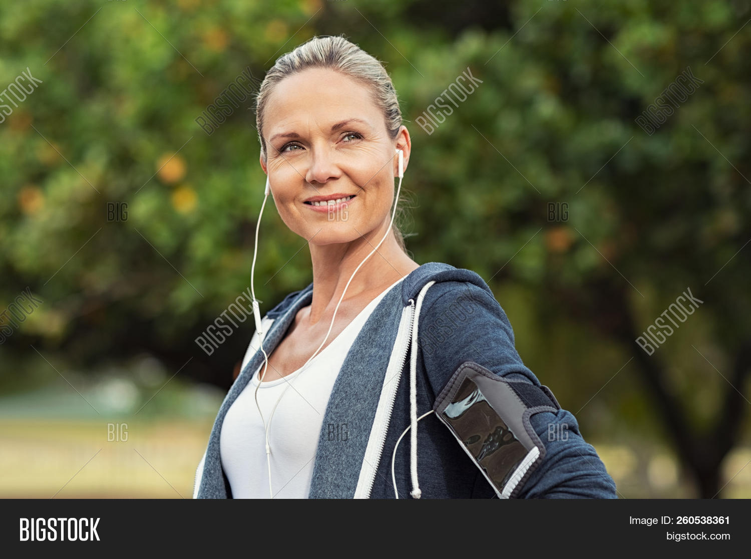 40 years,40s,activity,armband,autumn,beautiful,beautiful woman,blonde hair,break,determination,determined woman,earphones,exercise,female,fit,fitness,fitness training,happy,healthy,jacket,jogger,jogging,listening to music,looking away,mature,matured,mid,mid adult woman,music,outdoor,park,people,portrait,proud,resting,run,runner,satisfied,smartphone,smile,sport,sports,thinking,toothy smile,training,woman,workout