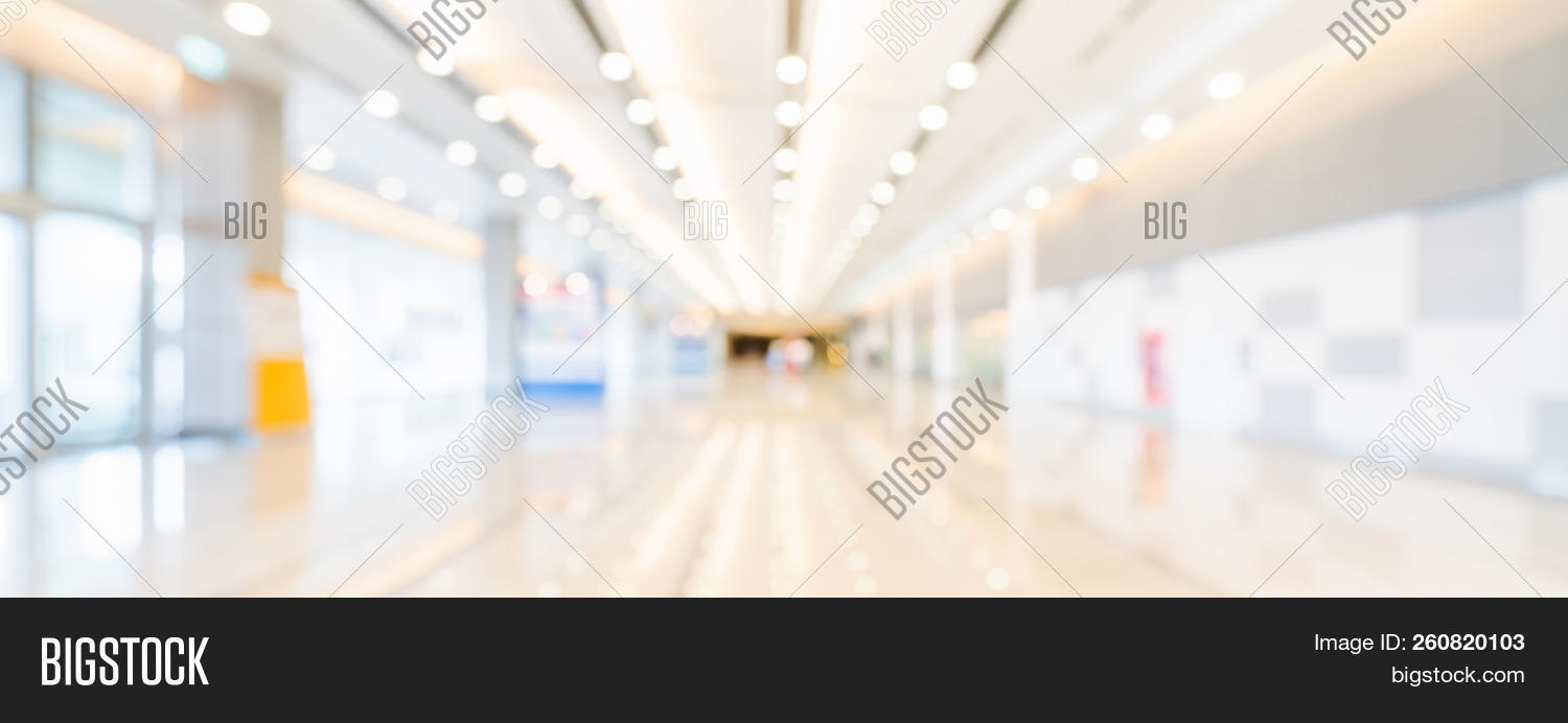 Blurred Bokeh Panoramic Banner Background Of Exhibition Hall Or Convention Center Hallway Business 260820103 Image Stock Photo