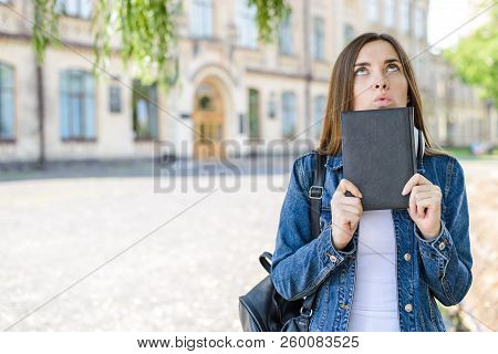 Boredom nerd lazy dream wish desire people person worried tired exhausted concept. Close up photo portrait of confused concentrated focused girl trying to remember information looking up stock photo