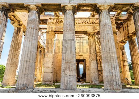 Temple of Hephaestus in sun light, Athens, Greece. It is one of the main landmarks of Athens. Sunny view of the ancient Greek Temple of Hephaestus in summer. Historical postcard of classic Athens. stock photo
