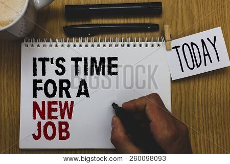 Conceptual hand writing showing It s is Time For A New Job. Business photo text Career changes seeking other work Recruitment Written on paper hand hold pen clipper grip sticky note black pen. stock photo