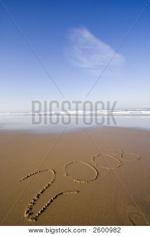 the 2008 year writen at the beach stock photo
