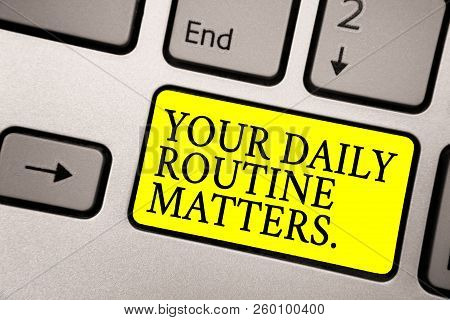 Word writing text Your Daily Routine Matters. Business concept for Have good habits to live a healthy life Grey silvery keyboard with bright yellow color button black color texts. stock photo