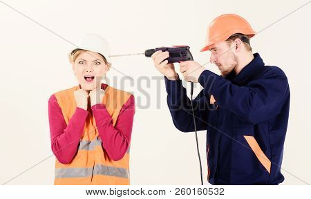 Woman with screaming face in helmet, hard hat. Husband annoying stock photo