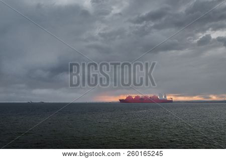 LNG TANKER - Rain and stormy dramatic clouds over a gas terminal in Swinoujscie stock photo
