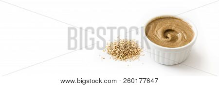 Tahini and sesame seeds isolated on white background. Panoramic view. Copyspace stock photo