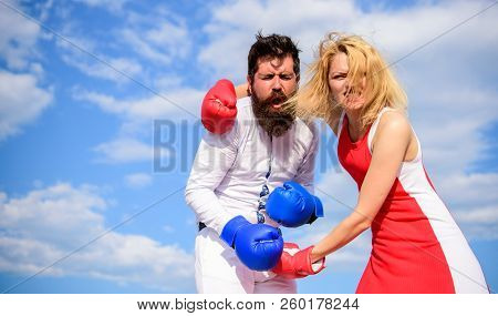 Struggle for gender equality. Attack is best defence. Man and woman fight boxing gloves sky background. Couple in love boxing. Defend your opinion in confrontation. Women can fight back concept stock photo