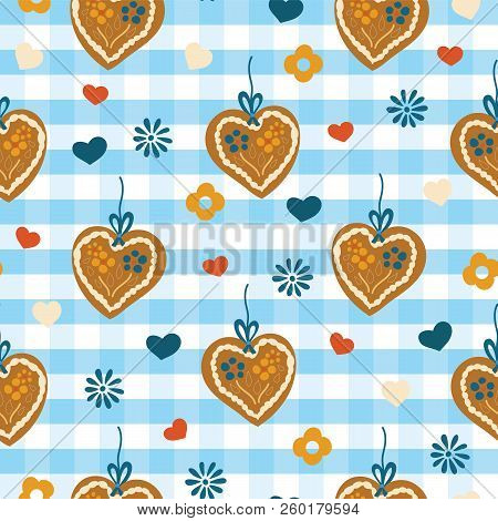 Oktoberfest Lebkuchenherz Gingerbread heart seamless vector pattern on a blue and white checkered background with blue, red, and white hearts and flowers. Great for backgrounds, fabric, and packaging. stock photo