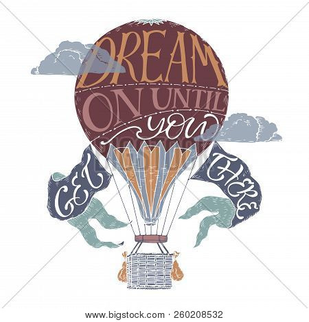 Brush lettering inspiration quote in a color vintage hot air balloon saying Dream on until you get there. stock photo