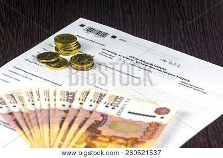 Russian annual tax Declaration of taxes of individuals. The Form 3-NDFL. A few Russian notes and coins are on the sheet of the Declaration. stock photo