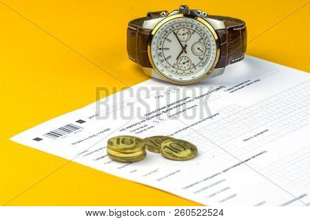 Russian annual tax Declaration of taxes of individuals. The Form 3-NDFL . A few Russian coins and watch are on the sheet of the Declaration. stock photo