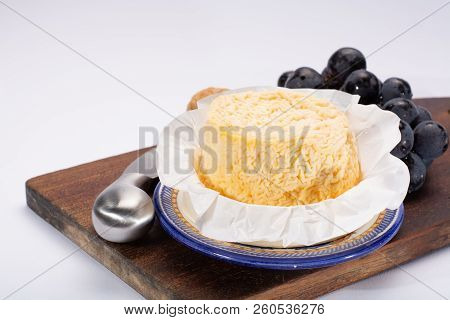 French AOC Langres soft cow crumbly cheese with washed rind structure made in Champagne-Ardenne region stock photo