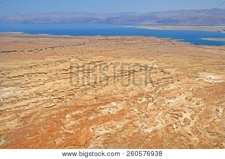 view from the height of the dead sea in Israel and the mountains of Jordan. the formation of karst trenches in the Judean desert. stock photo
