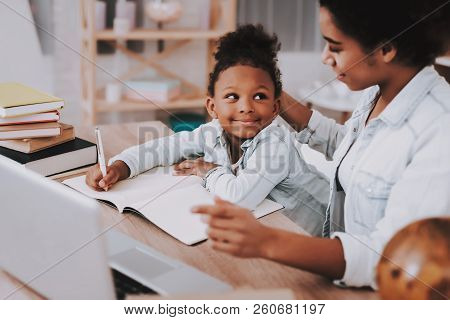 Studio and  mother and  Girl. Test with Mother. Work with Girl. Relax for Mother and Daughter. Study and Think for Mother. People and Work. Mother Smile and Girl Smile. Young Daughter.. stock photo