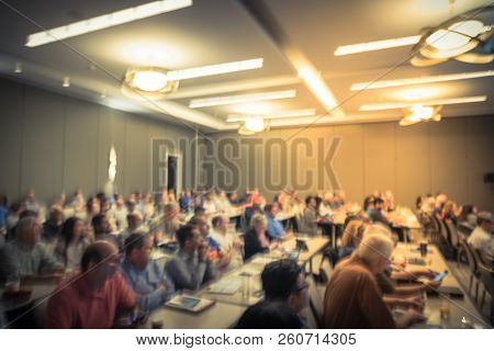 Filtered Tone Blurry Background Multiethnic People At Workshop In Hotel Convention Center